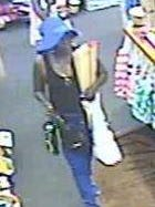 This is one of two surveillance images showing a woman who is wanted in Rehoboth Beach for using stolen credit cards.