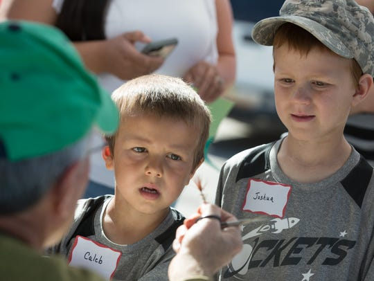 Caleb Greenwood, 5, and his brother Joshua, 7, both