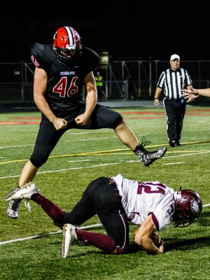 Pewaukee defensive lineman Jarrett Schmitz (46) celebrates tackling Jefferson's Evan Anfang (32) in the backfield during the Level 1 Division 3 playoff game at Pewaukee on Friday, Oct. 20.