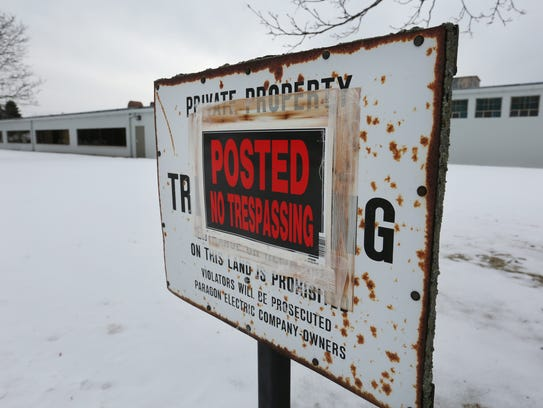 "One of several ""No Trespassing"" signs on the former"