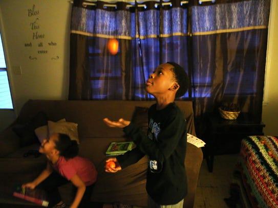 Jeremiah Harrell juggles in his living room.