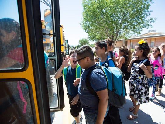 Jornada Elementary School students enter on to their