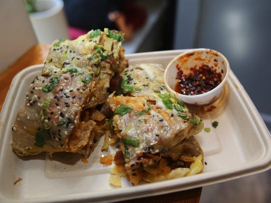 A  pork crepe that is folded in to a sandwich at the