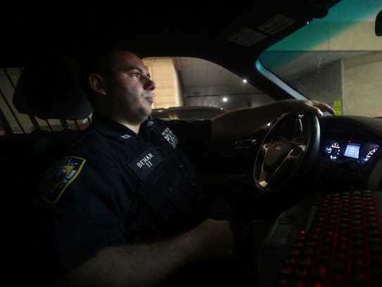 Port Chester police officer Jason Behar drives his