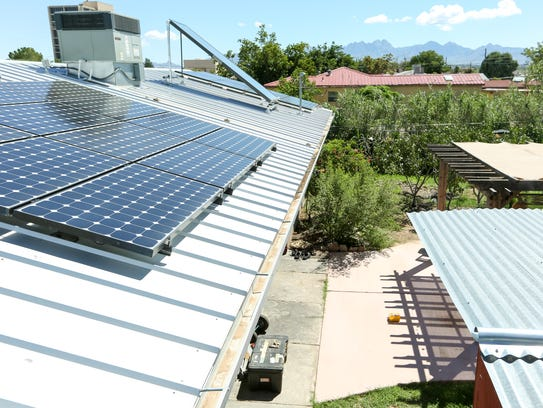 Solar panels on top of the Westbrook home generate
