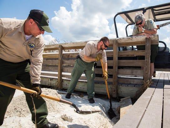 Park rangers staff Chris Tretter, from left, Tanner