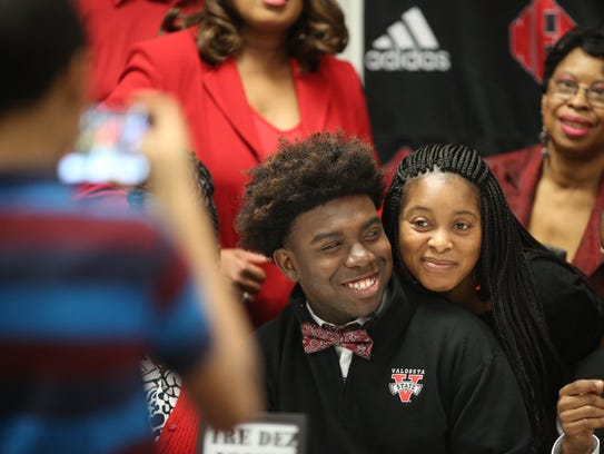 NFC's Tre'Dez Jones takes a photo with his aunt during