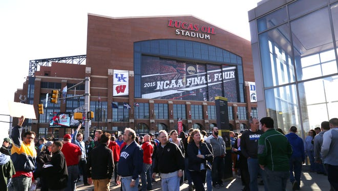 Final Four fans head to Lucas Oil Stadium in Downtown Indianapolis for the two NCAA Men's Division 1 Final Four semifinal games on April 4, 2015.