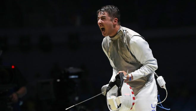 Alexander Massialas (USA) celebrates after facing off against not-pictured Artur Akhmatkhuzin (RUS) during men's fencing competition in the Rio 2016 Summer Olympic Games at Carioca Arena on Aug. 7.