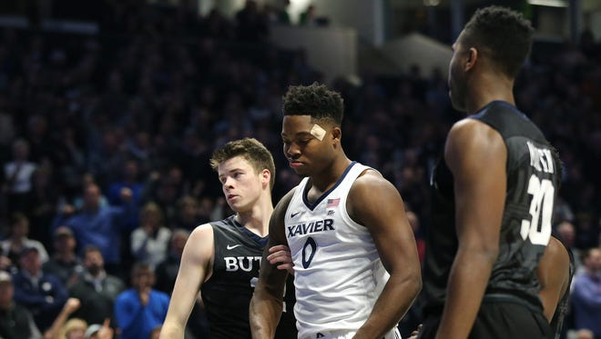 Xavier Musketeers forward Tyrique Jones (0) reacts after making a basket and drawing a foul in the second half during the NCAA basketball game between the Butler Bulldogs and the Xavier Musketeers, Tuesday, Jan. 2, 2018, at Cintas Center in Cincinnati. Xavier won 86-79.