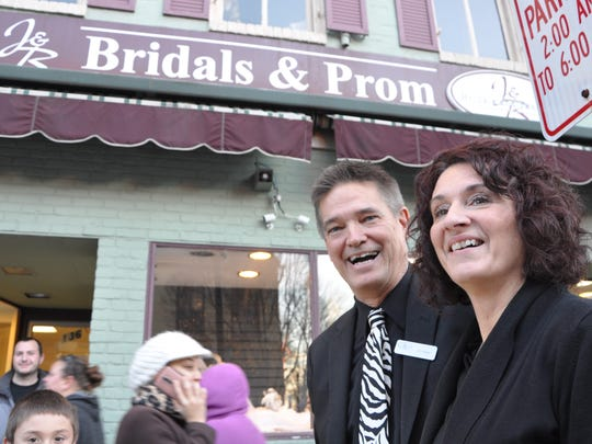 Jim and Barb Resh are pictured outside of their store, J&B Bridals and Tuxedos, which is currently at the peak of prom dress shopping season.