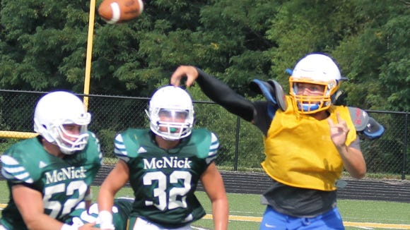 CNE quarterback Shawn Lykins throws on the run in a scrimmage against McNick prior to last season.