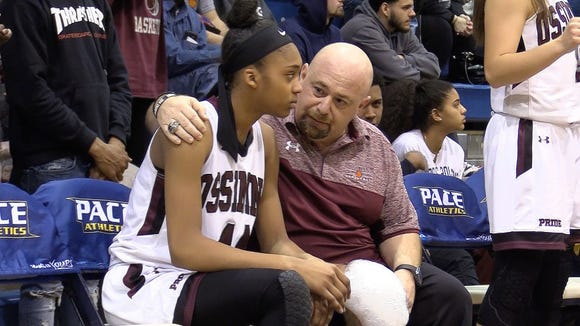 Ossining coach Dan Ricci talks with Aubrey Griffin (44) after she came out with a late game injury against Elmira during the girls basketball regional championship game at Pace University in Pleasantville March 9, 2018. Ossining won the game 90-78.