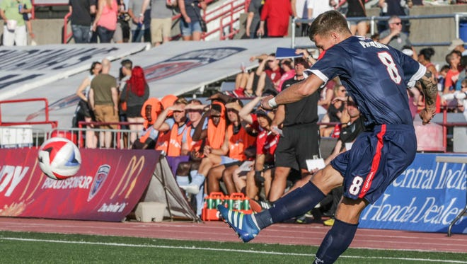 FILE -- Indy Eleven player Nicki Paterson passes the ball during the season opener game against Minnesota United FC at Carroll Stadium on IUPUI's campus, Saturday July 9th, 2016. The Indy Eleven defeated Minnesota United FC 1 to 0.