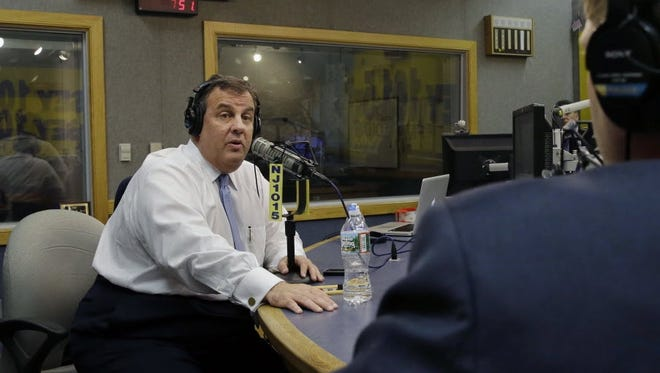 Gov. Chris Christie sits in a studio during his radio program, Ask the Governor broadcast on NJ 101.5, Monday, Feb. 3, 2014, in Ewing, N.J.
