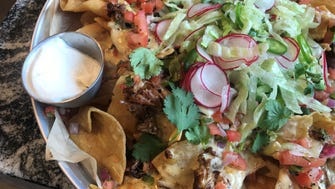Nachos are smothered with beer cheese, brisket burnt ends and all the fixings at Tavern at The Point, which replaced longtime Old Point Tavern, 401 Mass Ave., Indianapolis.