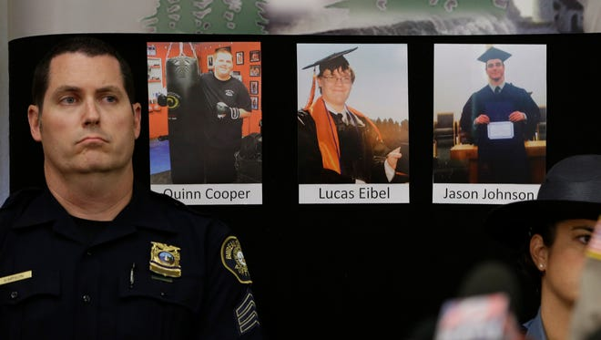 The photos of three of the victims of the mass shooting at Umpqua Community College are displayed at a news conference, Friday, Oct. 2, 2015, in Roseburg, Ore.  In the photos, from left, are Quinn Cooper, 18, Lucas Eibel,18,  center, and Jason Johnson, 33.  They were among those killed when Chris Harper Mercer, walked into a class at the community college, Thursday, and opened fire.  At left is Portland Police Sgt. Pete Simpson.