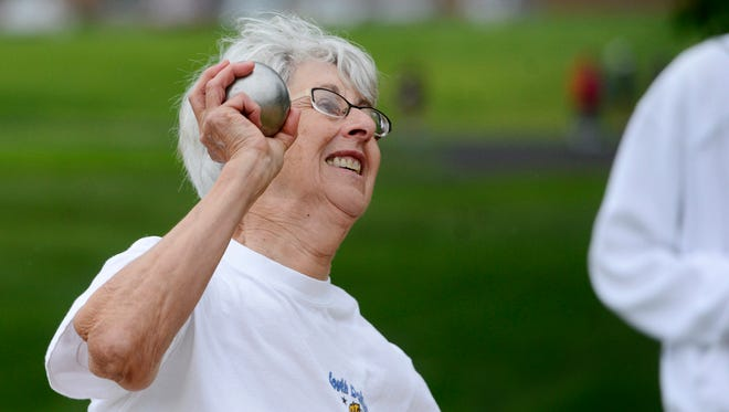 Harriet Kaufman of Freeman competes in the shot put at the 2014 South Dakota Senior Games in Sioux Falls. She is still active at age 78.