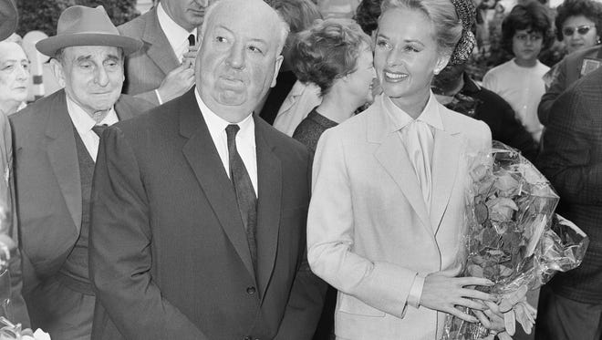 In this May 9, 1963 file photo, director Alfred Hitchcock and actress Tippi Hedren arrive at the Carlton Hotel in Cannes, France, to present the film 'The Birds.'