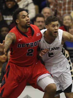 Oakland's Dante Williams defends against the Detroit Mercy's Juwan Howard Jr. during the first half on Feb. 15 in Rochester.