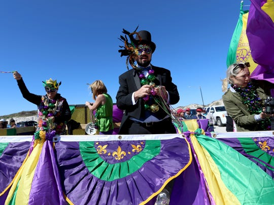 Members of the Port Royal Ocean Resort toss beads and candy to spectators during the seventh annual Barefoot Mardi Gras parade Saturday, Feb. 6, 2016, in Corpus Christi. The eighth annual Barefoot Mardi Gras on Padre Island will be this Saturday.
