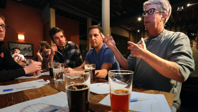 The banter is engaging at Bernie's Tap Room in Waukesha, Wis.,where a group of up to 25 regularly meets to discuss theology, with Pastor Brandon Brown. They drink craft beer and talk about theology and society.