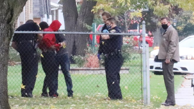 Pontiac Police secure a man north of where a stabbing took place on Illini Avenue Tuesday morning. The suspect, Anton R. Jones, had a puncture wound to the abdomen and was taken to OSF Saint James-John W. Albrecht Medical Center and then transferred to OSF Saint Francis in Peoria.