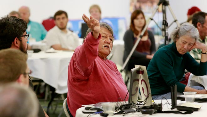 Shiprock farmer Gilbert Yazzie voices his concerns during a discussion of the environmental condition of the Animas and San Juan watersheds on Wednesday at the Henderson Fine Arts Building at San Juan College.