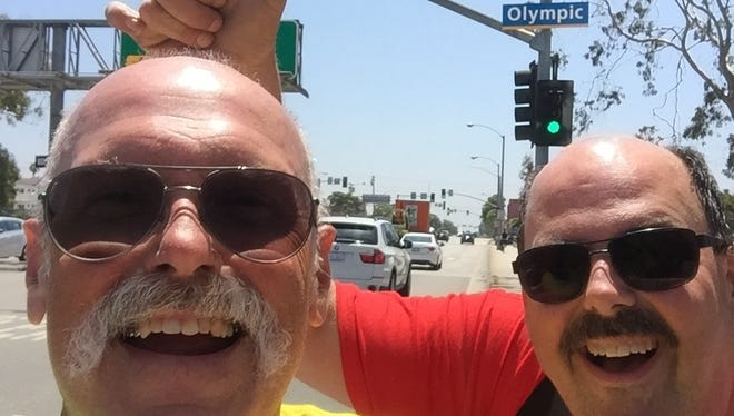 Bill Davis (left) and Dale Sunderman met their motorcycle adventure goal and reached the end of Route 66 in Santa Monica on July 20.