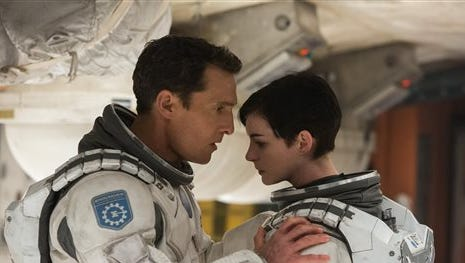 """This photo released by Paramount Pictures shows, Matthew McConaughey, left, and Anne Hathaway, in a scene from the film, '""""Interstellar."""" The film, directed by Christopher Nolan, received only one Golden Globe nomination for best original score on Thursday."""