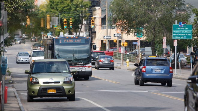 An RTS bus heads east on East Avenue before turning on Alexander Street in Rochester on Sept. 2, 2014.