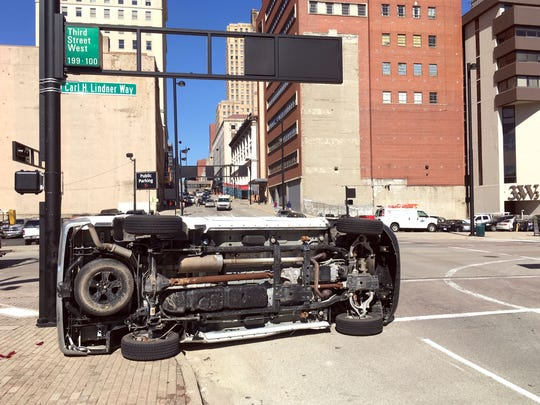 A car and truck collided Downtown Monday causing the truck to overturn. No one was injured.