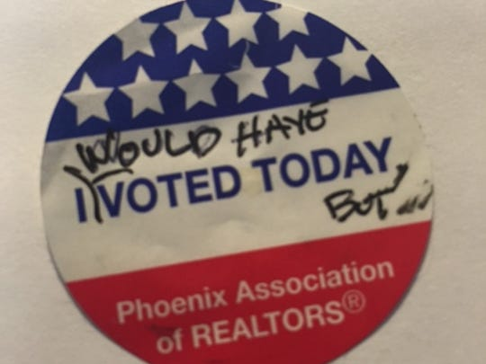 A modified voter sticker sent anonymously to azcentral