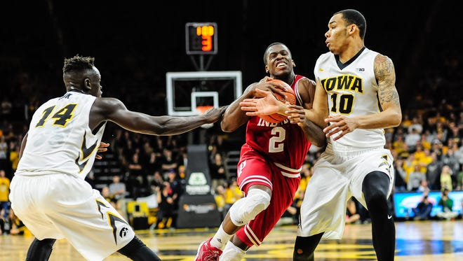 Indiana Hoosiers guard Josh Newkirk (2) goes to the basket as Iowa Hawkeyes guard Christian Williams (10) and guard Peter Jok (14) defend during the first half at Carver-Hawkeye Arena.