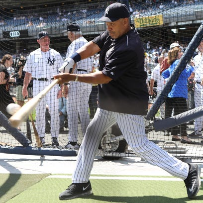 Reggie Jackson connects during batting practice at