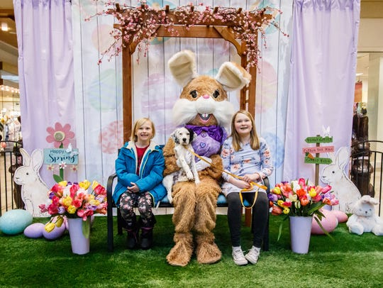 Olivia, 6, and Emma Petersen, 10, of Milwaukee brought Bailey, their English Setter puppy for a visit with the Easter Bunny at Center Court in Brookfield Square Mall on Monday, March 19, 2018.