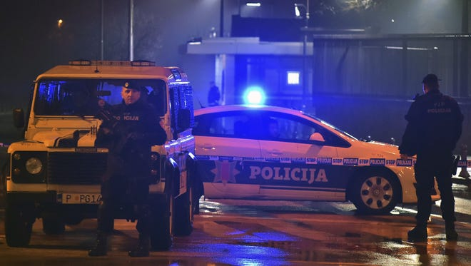 Police block off the area around the U.S. Embassy in Montenegro's capital Podgorica, Thursday, Feb. 22, 2018. Montenegro says an attacker threw a grenade at the U.S. Embassy in the capital of the Balkan state then killed himself with another explosive device.