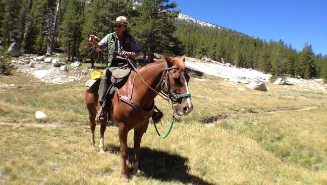 A ranger patrols Yosemite National Park near the Tuolumne River along the John Muir Trail on Aug. 18, 2014.