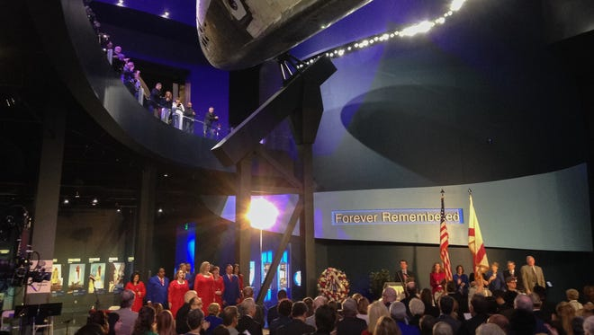 People gather to remember the crew of the space shuttle Challenger on the 30th anniversary of the disaster