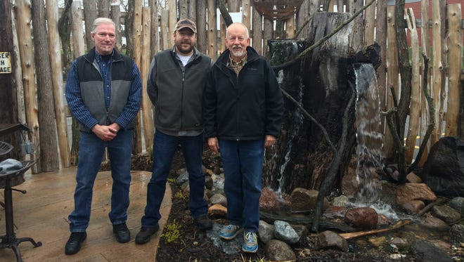 Terry Blumberg, left, Ben Swanson of Sconni's, middle, and Tom Rau, of The Neighbors' Place, right, at Sconni's Monday.
