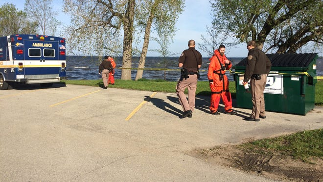 Authorities at High Cliff State Park marina where a body has been found in Lake Winnebago on Friday, May 13, 2016.