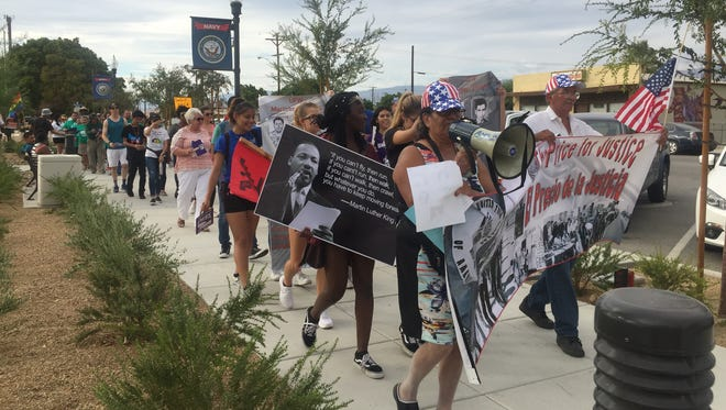 Clementina Olleque, left, and Tony Lopez lead marchers at a rally in Coachella on Sunday.