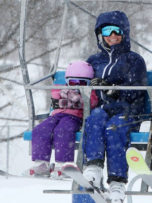 Kendra Holze, and her daughter Skye, ride the chairlift as they enjoy the fresh fallen snow at Thunder Ridge Ski Area in Patterson Feb. 9, 2017.