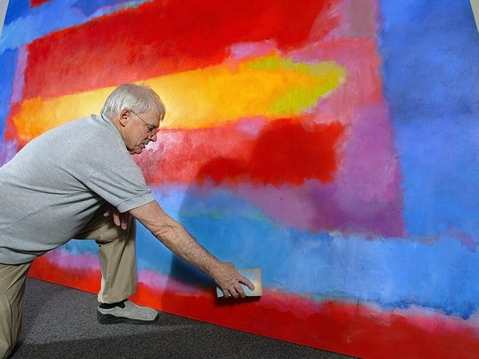 Trevor Bell cleaning painting art