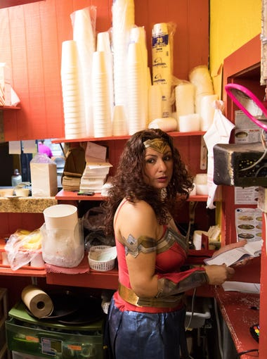 Monica Rocha in a Wonder Woman Halloween costume looks over to front door of Monica's Restaurant on Oct. 31, 2017. Monica who was brought over from Mexico at the age of four was an undocumented immigrant and only about to buy her restaurant after receiving DACA.