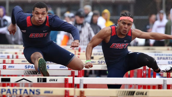 Brookfield East's Abel Christiansen (right) owns the second-fastest time in the state in the 300 -meter intermediate hurdles.