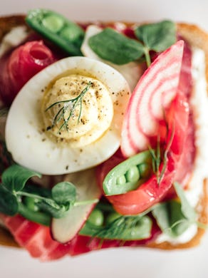 Two-time James Beard Award nominee, Steven Brown offers a menu of delectable small plates, classic French bistro entrees and scrumptious tartines. For example, the saumone d'été tartine is stacked with beet-cured salmon, deviled eggs, snap peas and fromage blanc.