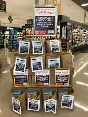 Customers at ACME Market stores can purchase prepared food bags for the company's annual Holiday Food Drive. ACME will then distribute the food bags to local food banks.