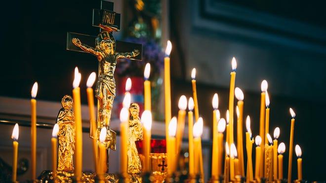 Church candles at dark background