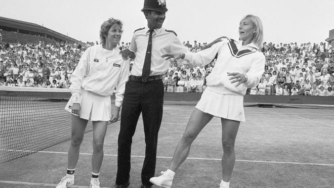 In this July 4, 1985, photo, Chris Evert, left, and Martina Navratilova joke with Police Constable Les Bowie on Number Two Court at Wimbledon.